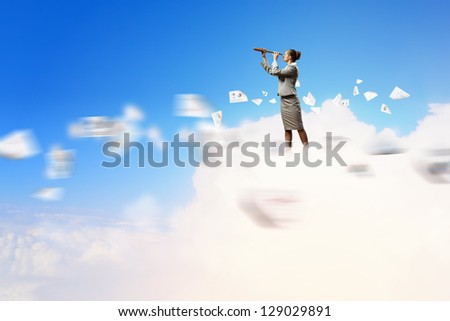 Image of businesswoman looking in telescope standing atop of cloud - stock photo