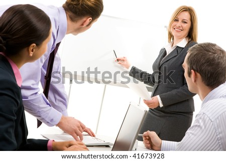 Image of businesswoman making report at working meeting - stock photo