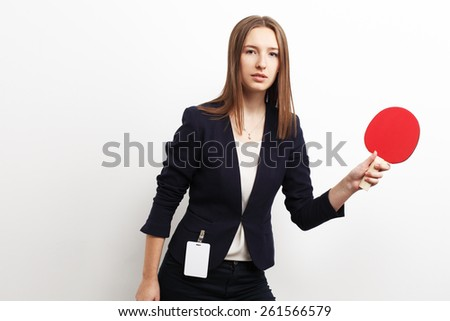 Image of businesswoman playing tennis over white background - stock photo