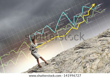 Image of businesswoman pulling graph of diagram