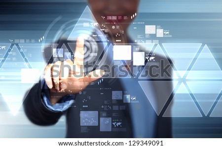 image of businesswoman touching screen with finger - stock photo
