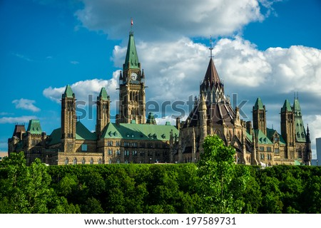Image of Canada's Parliament Hill and Parliament Buildings, the seat of the federal government of Canada, taken from the back side of the buildings. - stock photo