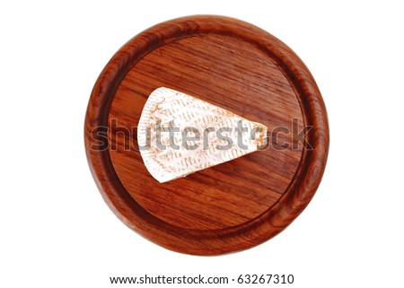 image of cheese on red wooden plate - stock photo