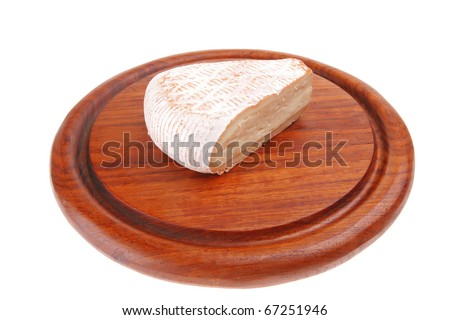 image of cheese on wood over white - stock photo