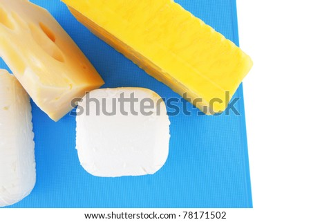 image of cheeses on blue plate over white - stock photo