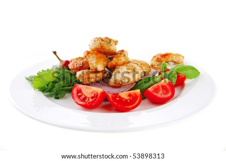 image of chicken brisket chunks on vegetables - stock photo