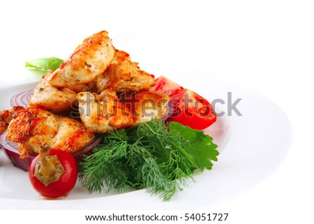 image of chicken brisket chunks on vegetables - stock photo