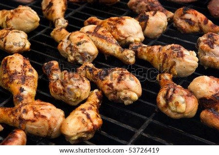 Image of chicken cooking on a grill - stock photo