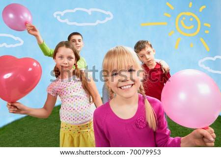 Image of children holding balloons with girl in front - stock photo