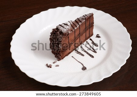 Image of chocolate cake with powdered sugar - stock photo