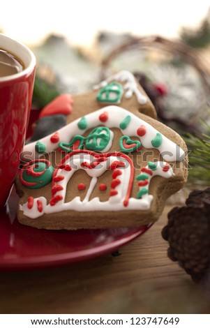 Image of christmas cookie with hot chocolate on red plate - stock photo