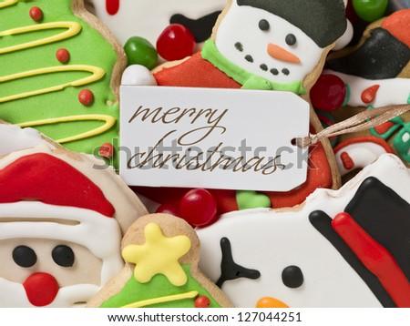 Image of christmas greeting tag and christmas cookies - stock photo
