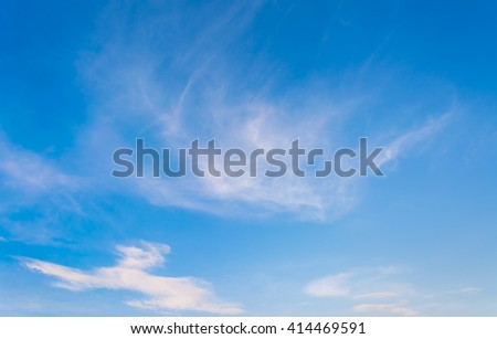 image of clear blue sky and white clouds on day time for background usage .