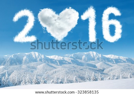 Image of cloud shaped numbers 2016 and heart symbol on the sky above snowy mountain. New year concept - stock photo