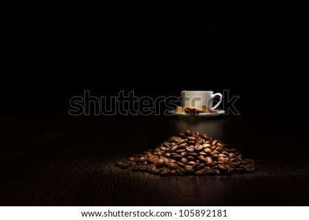 Image of coffee beans and white cup - stock photo