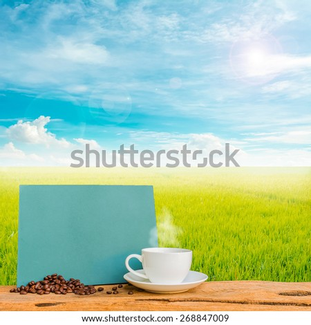 image of coffee cup and  rice field with clear blue sky for background usage . - stock photo