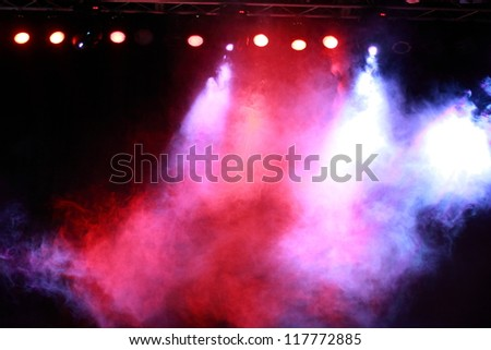Image of colorful concert lighting against a dark background - stock photo
