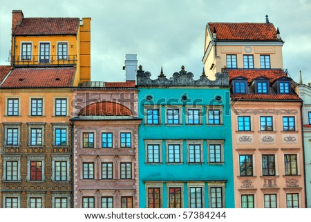 Image of colorful old houses in the main town square in Warsaw, Poland enhanced by use of HDR techniques - stock photo