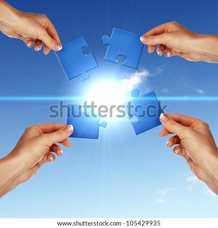 Image of colour puzzle pieces and human hand - stock photo