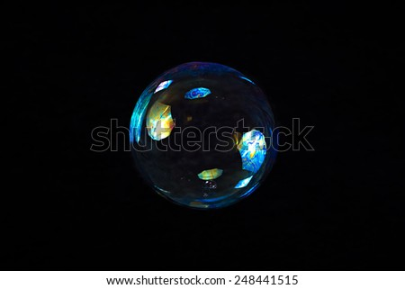 Image of colour soap bubble on black background - stock photo