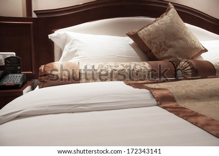 Image of comfortable pillows and bed. - stock photo
