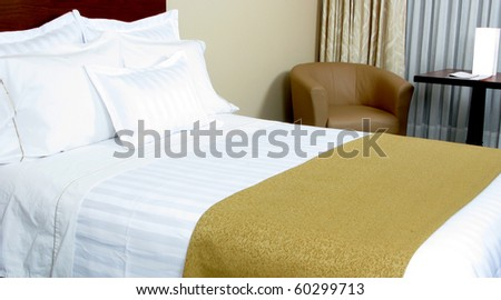 Image of comfortable suite with pillows and bed. - stock photo