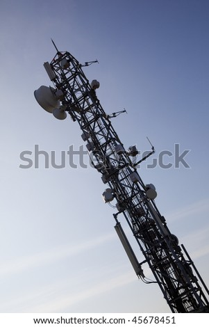 image of communication mobile internet antenna over a blue sky background