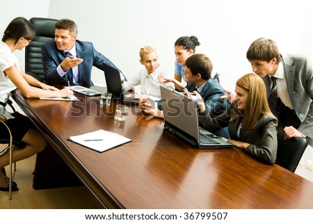 Image of company of successful partners communicating at meeting - stock photo
