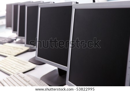 Image of computers on the table in line - stock photo