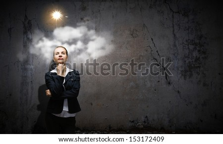 Image of concentrated businesswoman looking for answer - stock photo