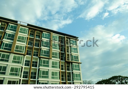 image of condo on afternoon with Blue Sky - stock photo