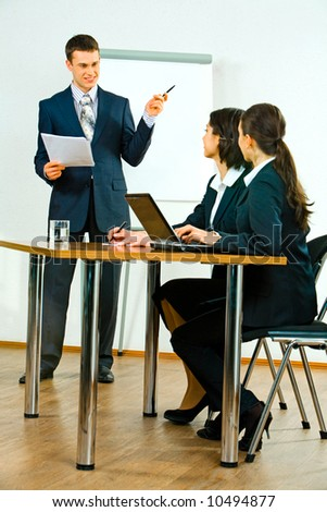 Image of confident business man talking about marketing to women - stock photo