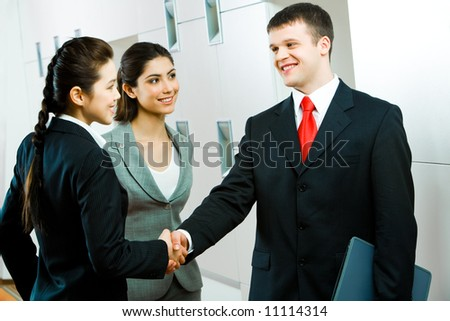 Image of confident business person shaking hands making an agreement - stock photo