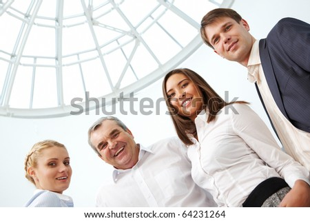 Image of confident business team looking at camera with smiles - stock photo