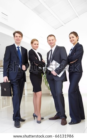 Image of confident business team posing in front of camera