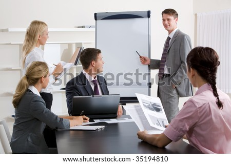 Image of confident businessman doing a presentation at business conference - stock photo