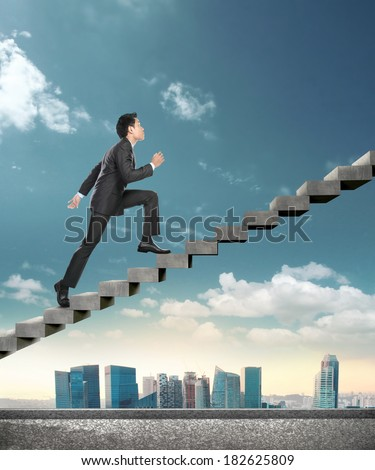 Image of confident businessman walking upstairs. conceptual images of business - stock photo