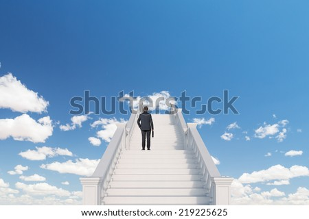 Image of confident businessman with briefcase walking upstairs to the sky.  - stock photo