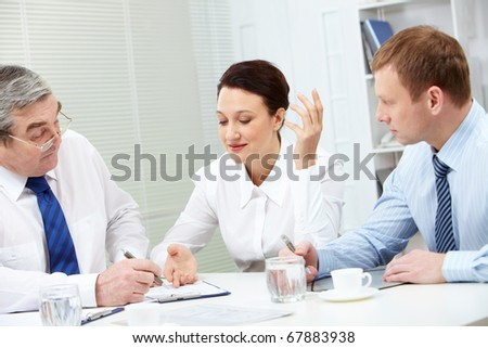 Image of confident colleagues looking for new strategy at meeting - stock photo