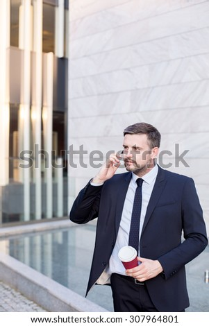 Image of confident financial worker in suit working outdoor - stock photo