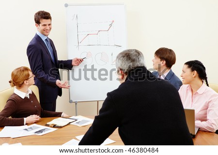 Image of confident man making presentation and interacting with the audience