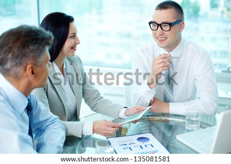 Image of confident partners interacting at meeting - stock photo