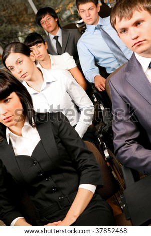 Image of confident people listening to lecture at conference - stock photo