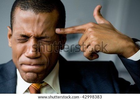 Image of confused man touching his temple with forefinger in trouble - stock photo