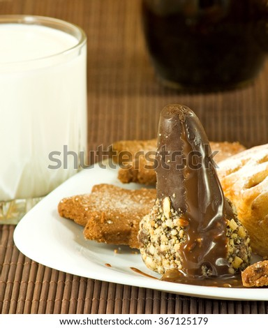 Image of cookies and a glass of milk closeup - stock photo