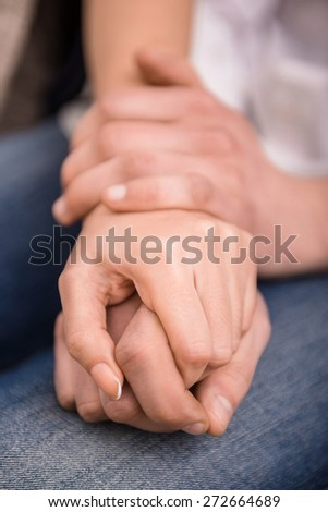 Image of couple are holding hands. Concept of love.
