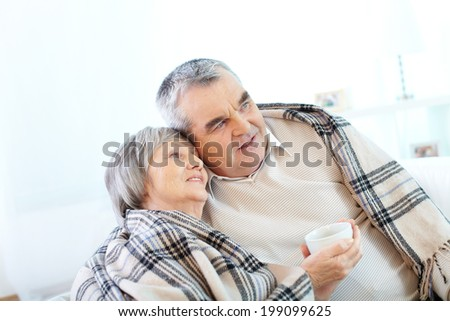 Image of couple of pensioners having tea at home - stock photo