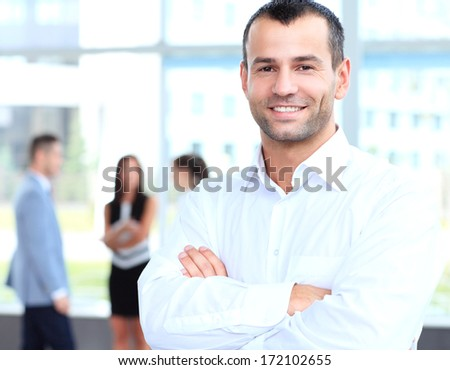 Image of cross-armed leader looking at camera in working environment  - stock photo