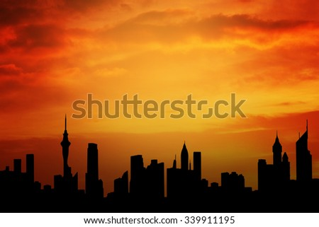 Image of crowded skyscrapers with colorful sky at sunset time