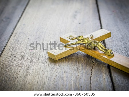 image of crucifix of Jesus Christ  on wooden background - stock photo